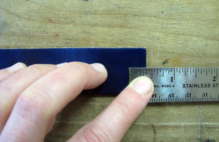 Measure where to place your snaps on your leather strap
